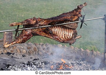 Delicious roast lamb on a spit over an open fire