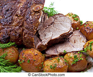 Closeup roast leg of lamb with potatoes and dill. Isolated over white.