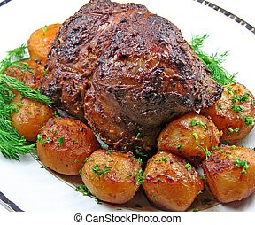 Roast leg of lamb - Plate with roast leg of lamb, potatoes...