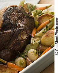 Roast Leg of Spring Lamb With Roast Potatoes and Vegetables