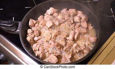 Roast meat in a skillet. 4K.