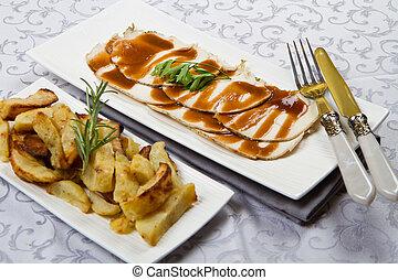roast of pork with potatoes
