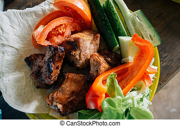 roast pork barbecue with vegetables on a plate
