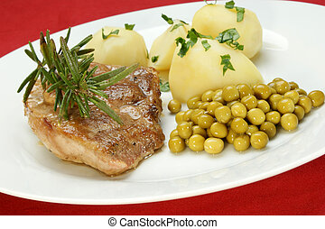 Roast pork with boiled potatoes and peas