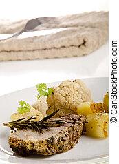 roast pork with fried potatoes and cauliflower