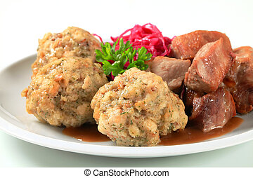 Roast pork with Tyrolean dumplings and red kraut - Dish of ...
