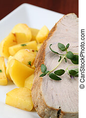 Roast tuna steak with potatoes