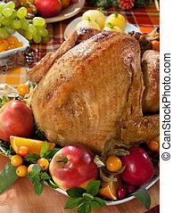 roasted turkey on holiday decorated table