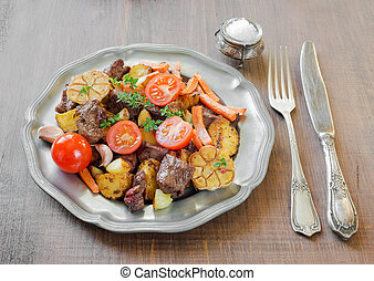 Roast wild game with vegetables - Roast venison meat with...