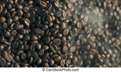 Roasted and smoking coffee beans. Vertical footage. - Macro ...