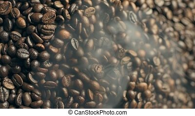 Roasted and smoking coffee beans. Vertical footage. - ...