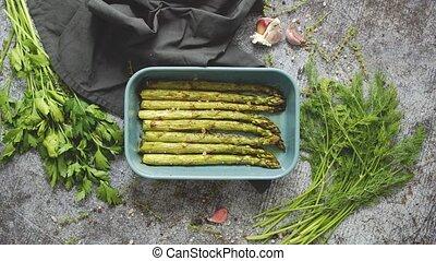 Roasted asparagus seasoned with salt, pepper, garlic and ...
