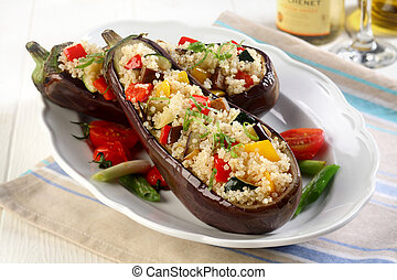 Roasted aubergine with savory filling of couscous with diced...