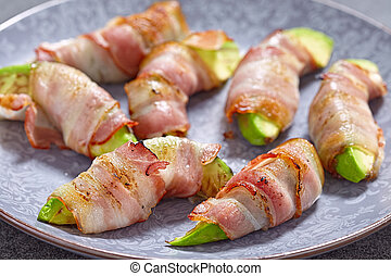 Roasted avocado pieces wrapped in bacon