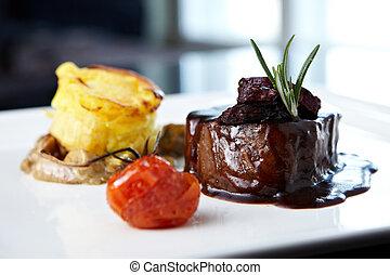 Roasted beef tenderloin with herb-potato muffin, mushroom...