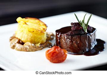 Roasted beef tenderloin with herb-potato muffin, mushroom ...