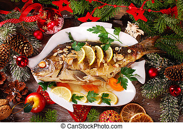 roasted carp stuffed with vegetables for christmas - roasted...