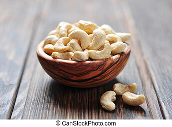 Roasted cashews on natural wooden table background