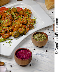 Roasted cauliflower with sprouts, beans .