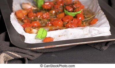 Roasted cherry tomotoes. Mediterranean food recipe idea.