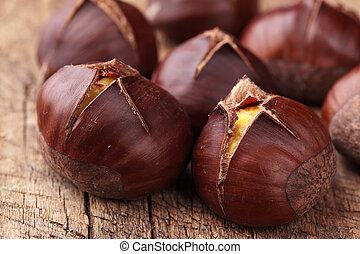 Roasted chestnuts on wooden background