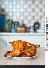 Roasted chicken on the plate in kitchen