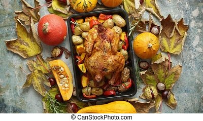 Roasted chicken or turkey garnished with pumpkins, pepper ...