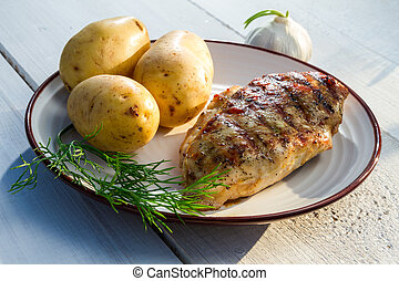 Roasted chicken served with potatoes and dill