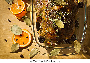 Roasted chicken with orange fruit and dried plums
