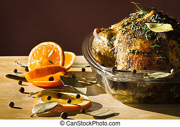 Roasted chicken with orange fruit and herbs