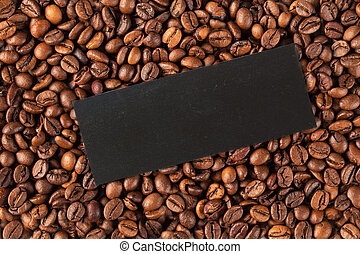 Roasted coffee bean background. Top view with copyspace
