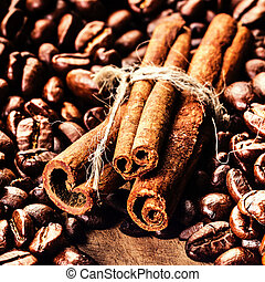 Roasted Coffee beans and cinnamon sticks on grunge wooden ...