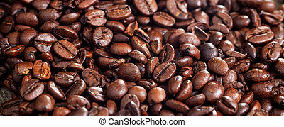 Roasted coffee beans background. Closeup view and details.