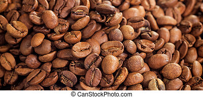 Roasted coffee beans background. Closeup view with details.
