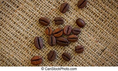 Roasted coffee beans background. - Natural brown roasted...