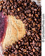 Roasted Coffee Beans background or texture. Coffee beans on old