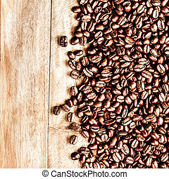 Roasted Coffee Beans background texture on wooden background...