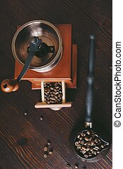 Roasted coffee beans in a copper Turk and coffee grinder