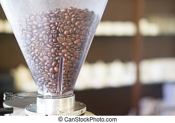 Roasted coffee beans in a grinder,