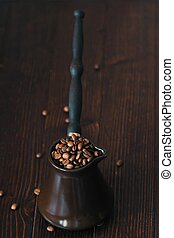 Roasted coffee beans in beautiful copper Turk