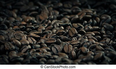 Roasted Coffee Beans In Sack Rotating Slowly - Closeup of...