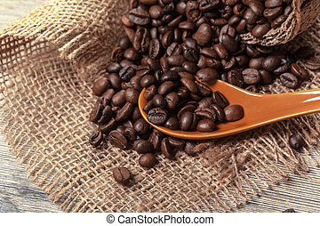Roasted coffee beans on a wooden floor