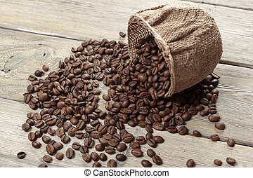 Roasted coffee beans on a wooden floor creative photo.