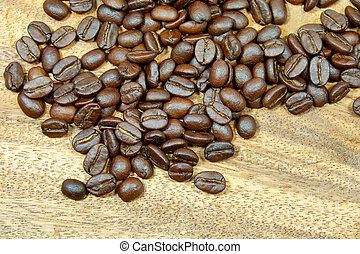 roasted coffee beans on wood.