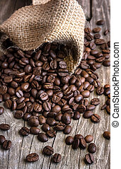 roasted coffee beans on wood