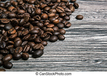 roasted coffee beans on wooden gray background top view