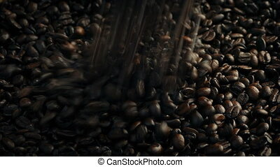 Roasted Coffee Beans Poured Into Pile - Closeup shot of...
