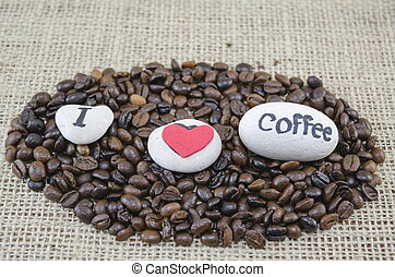 """Roasted coffee beans with an """"I love coffe"""" message"""
