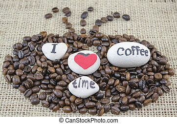 """Roasted coffee beans with """"I love coffe time"""" message"""