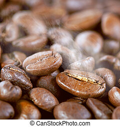 Roasted coffee beans with steam